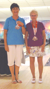 "Diane Stepneski and Alberta Wambold display the silver medals they earned during the National Senior Games in Cleveland in 2013. ""I would tell people of all ages, but especially seniors, that bowling is something that you should get into immediately. It's been one of the best things in my life,"" says Wambold."