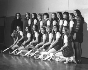 Adams is pictured with the first Eastridge High School varsity field hockey team in the fall of 1970 in Irondequoit. Adams taught physical education and both instituted and coached girls sports teams there. She was inducted into The College at Brockport State University of New York's Athletic Hall of Fame in 1993.
