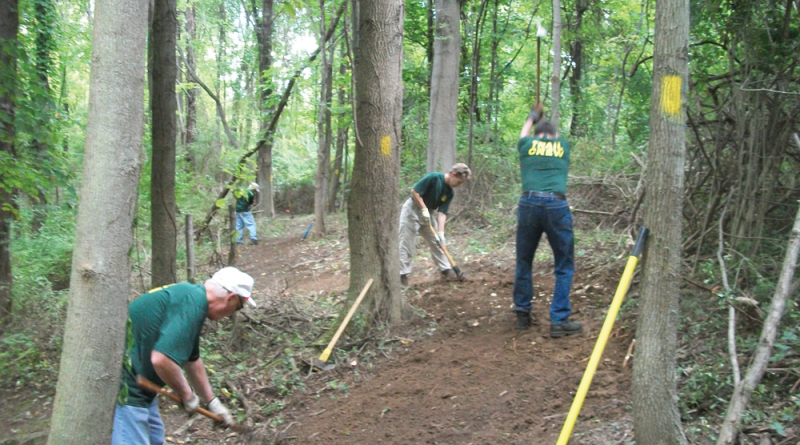 Labor of love: Group of volunteers at Friends of Webster Trails spends several Saturdays cleaning the trails, making sure they are marked correctly while performing landscaping. Typically, anywhere from 20 to 30 people give their time to help maintain the trails.
