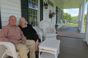 Bob Nezelek and his wife Lynda on the porch of their Another World Bed and Breakfast in Naples.