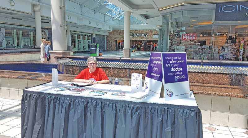 Laitenberger helping Relay for Life at Eastview Mall in Victor.