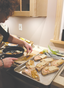 Maggie Odhner preparing a vegan dish known as tempeh reuben.