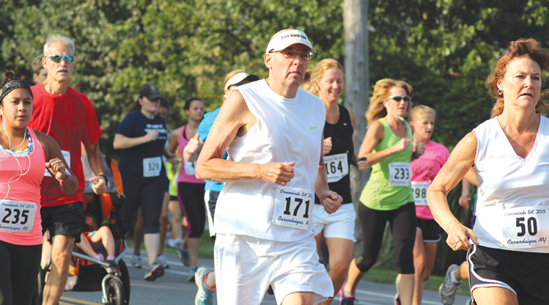 Bruce Rychwalski running in the Crosswinds 5K in Canandaigua last Sept. 5. Since being diagnosed with arrhythmogenic right ventricular cardiomyopathy and having implantable cardioverter defibrillator implantation surgery in 2011, Rychwalski has competed in 190 5K road races: 18 in 2011, 32 in 2012, 51 in 2013, 50 in 2014 and 39 in 2015. And he is still running.