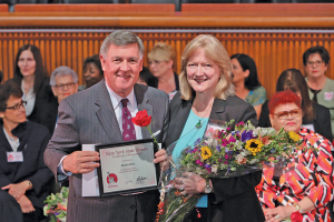 Bonnie Ross, executive director of Ontario County Partnership, is honored by state Senator Rich Funke with the 2015 Woman of Distinction Award.