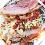 Belhurst Edgar's ham, eggplant parm, bacon, couscous salad, tomato salad: A sampling of carved ham, chickpea and couscous salad, heirloom tomato and orecchiette pasta salad, bacon and eggplant parmesan.