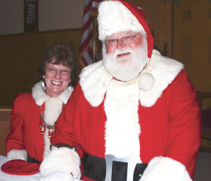 Santa and Mrs. Claus: Walt Krehling and his wife, Mary. Left photo: business card, gloves.