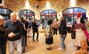 Guests dancing to Johnny Matt Band on a recent Friday night at Market Café at the Eastway Wegman's in Webster. The band has been a fixture on Friday nights at that location for seven years.