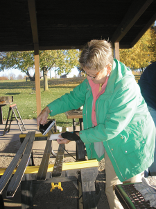 Trudy Munding waxing her skis in preparation for skiing. She is one of Huggers Ski Club's 300-plus members.