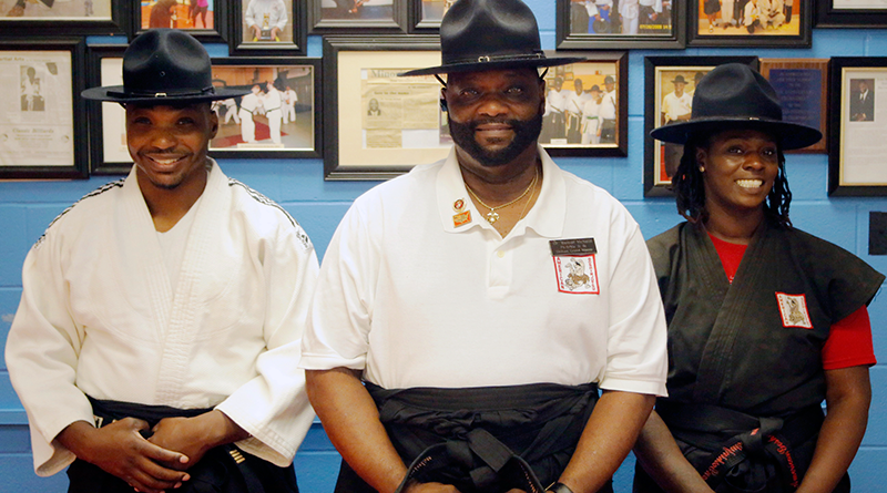 Kamae McNeill, ninth degree black belt, center, is shown with his son, Sampai Bushi Jermaine McNeill, fifth degree black belt, on his left and his daughter, Sensei Bushi Mercede McNeill, fourth degree black belt, on his right.