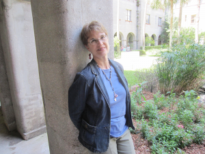 "Jeanne Gehret takes a minute to enjoy the garden at the Lightner Museum in St. Augustine, Fla., where she researched 19th century artifacts for her latest book, ""The Truth About Daniel."""
