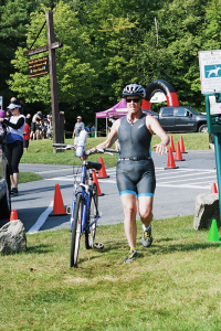 Margaret Newland enjoys running triathlons as one way of staying healthy. Newland, who owns Studio Renew Yoga in Geneva, recently took up snowboarding at 52.