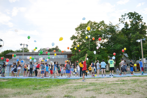 Campers at Camp Good Days and Special Times launch more than 100 balloons over Keuka Lake in Branchport during a summer program for children who have lost a parent or sibling to cancer. Photo provided.