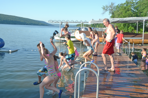 Campers at Camp Good Days and Special Times jump into Keuka Lake in Branchport