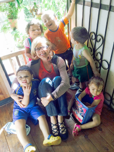 Dee Dee Williams takes a moment with some of the children at a government-sponsored daycare in Costa Rica, where she volunteered for five weeks in 2014. Photo provided