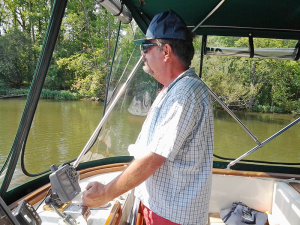 Jay Rodman, of Lakeville, at the helm of Cat's Meow. He, his wife and their friend Rob Hall took a 7,000-mile trip around the inner waterways of eastern North America.