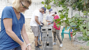 "Working with cement blocks in Guatemala through Habitat International. ""Seven of us had to move 1,600 cement blocks by hand,"" Williams said. Photo provided"