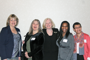 Nancy Bennet, middle, with some of her staff members from the Center for Community Health, during a recent event sponsored by the Monroe County Medical Society, which recognized Bennett with its Edward Mott Moore Award.