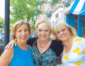 Solo Travelers Club members (from left): Deb Rouviere of Syracuse, Karen Sheldon and Sherry Gillis, both from Rochester, posed for this photo after enjoying a winery tour and lunch in Skaneateles.