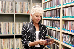 Kim Corcoran, one of the volunteer DJs at Jazz 90.1. She started volunteering at the radio station by working in the music library. After a year, she recommended the schedule add a Broadway music show, and she's now the DJ for it.