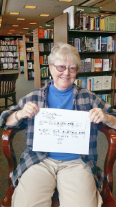 Patricia Decaro of Pittsford holding her family tree. Her research into her family's ancestors took her Washington, D.C., Georgia, Texas and Illinois. Among other things, she found a distant family connection to a infamous 19th century serial killer.