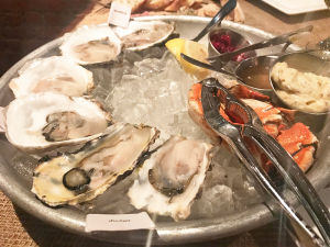 Seafood platter:Each type of oyster is marked with a little white flag.