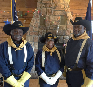 Buffalo Soldier color guard Robert Burgess, Shirley Boone and Bing Reaves, a retired police officer who helps run the group. Photo by Christine Green