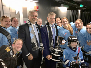 Ric Seiling with assistant coach, Craig Muni and the Buffalo Beauts.