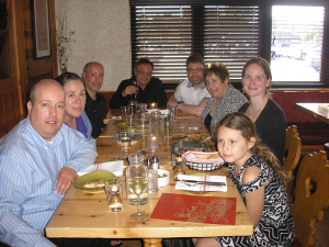 Mangione (center, back) at Wegmans East Avenue during the pre-screening get-together for Gli Ultimi Sarrano, which was shown on May 24. Mangione briefly joined the DeCarolis family and some friends at the table.