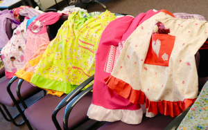 Sample of dresses made by member of the Savvy Sew-ers in Rochester.