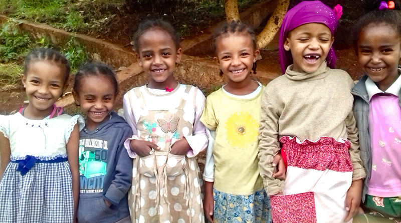 A group of girls from Mali sporting new dresses made by Savvy Sew-ers in Rochester
