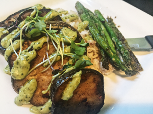 Light green roasted jalapeño aioli was drizzled on each eggplant wedge, providing the right amount of heat.