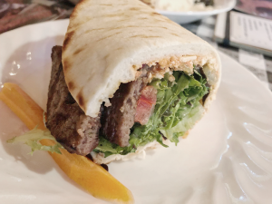 Spicy feta gyro is stuffed with flavorful gyro meat and veggies.
