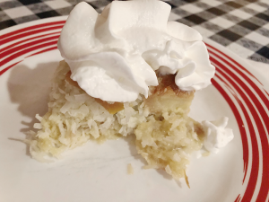 Olives' coconut bread pudding is coconut and apricot, topped with a dollop of whipped cream.
