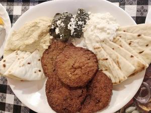 Platter starter: hummus, skadalia, dolmades, eggplant and pita.