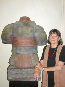 "Nancy Jurs with a sculpture from her ""armor"" series"