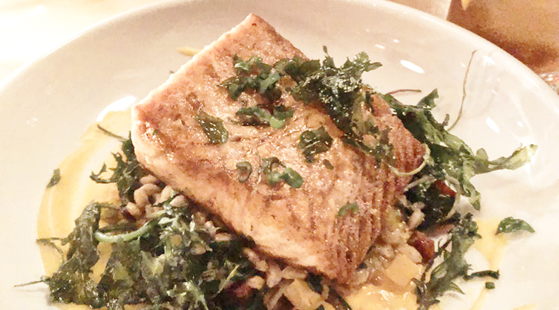 Salmon: The medium-rare cooked salmon sits on a bed of kale, butternut squash, farro, and chorizo.