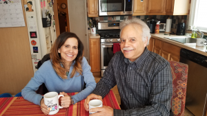 Annette Ramos and her husband at their home in Rochester.