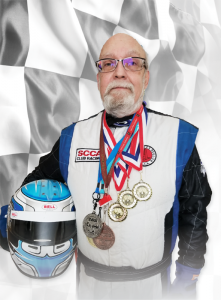 Auto racer Mark Green at his home in Avon, sporting some of the medals he has earned during his career. Photo provided.
