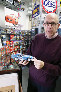 Mark Theobald, owner of Auto Antiques in Palmyra, shows a highly detailed model of a Shelby Daytona Coupe.