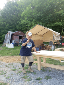 Michael Matteo at his Steuben County home with tables he built himself.