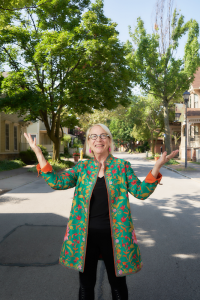 Suzanne Mayer in front of her home in the Grove Place neighborhood of Rochester on Aug. 2. Photo by Chuck Wainwright.