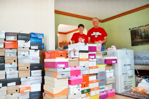 Joel and Pat Slesak of Greece have volunteered locally to get shoe boxes filled with school supplies, hygiene items and toys for needy children.