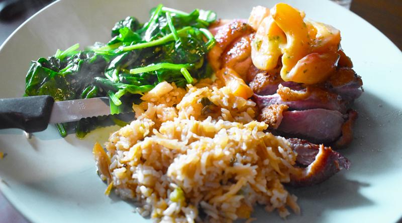 Red Dove Tavern's duck breast ($28) with the apricot-miso salad, daily fried rice, and sautéed spinach.