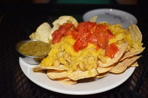 The mac and cheese nachos ($10.50) with chips and green olive salsa verde.
