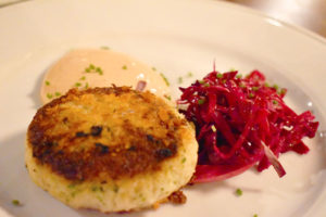 The hockey puck-sized crab cake was delightful with a lightly crisp outside and soft meaty inside.