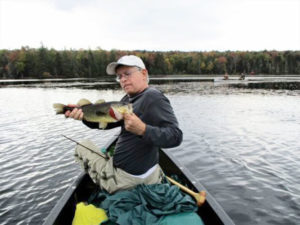 "Rochester-based writer Todd Etshman fishing with friends in the Adirondacks this fall. ""The value of enjoying something like an Adirondack Mountain fishing trip with several 55-plus friends in the fall is indeed, priceless."""