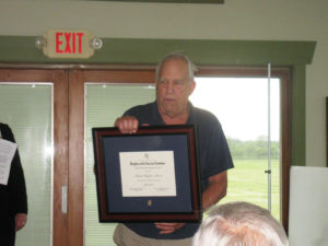 Austin Wadsworth, founder of the National Warplane Museum in Geneseo, receives an award for his work at the museum.