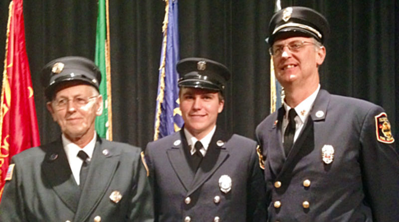 A very proud legacy: three generations of firefighters: Darwin Welker, from left, grandson D.J., and son John Welker.
