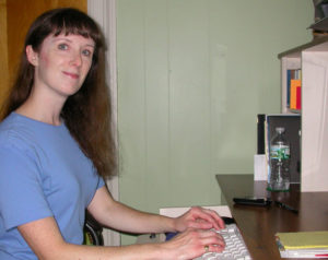Writer Deborah Sergeant working at her workstation at home. She has worked from home for 20 years and share some tips on how to be successful and productive.