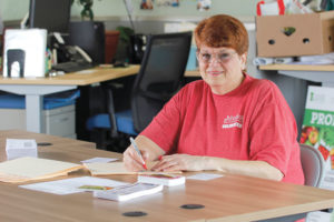 Debbie Leipold has been a volunteer for six years — and 848 shifts — at Foodlink. She works in a break room, preparing thank-you letters for people who donate money to the organization.